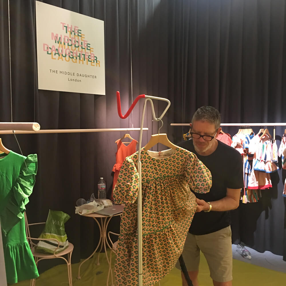 steaming a dress at trade show